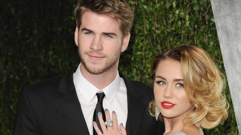 Miley Cyrus, right, and Liam Hemsworth at the