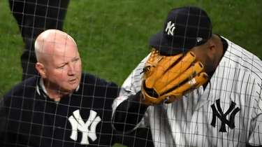 Yankees pitcher CC Sabathia leaves the game with