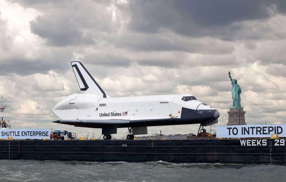 The Space Shuttle Enterprise is brought past the