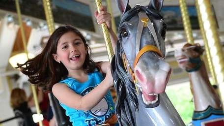 Halle Zweibel of Commack rides the Nunley's Carousel