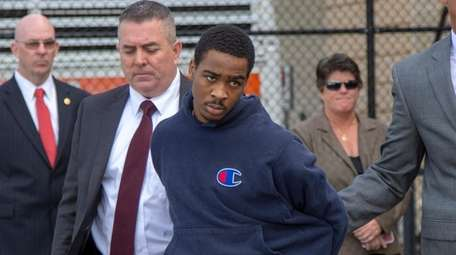 Antoine Foster leaves the Nassau Police headquarters in