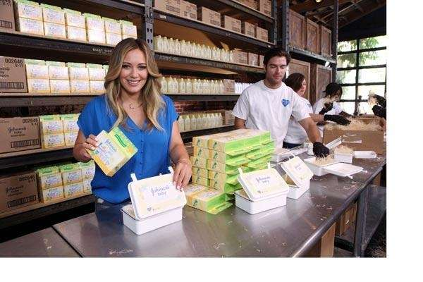 """Hilary Duff helps assemble """"Care Kits"""" for Johnson's"""