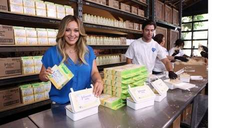 Hilary Duff helps assemble
