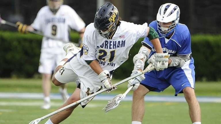 Shoreham-Wading River's Chris Mahoney fights for a ground