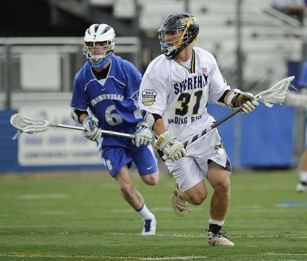 Shoreham-Wading River's Trevor Brosco drives to the goal