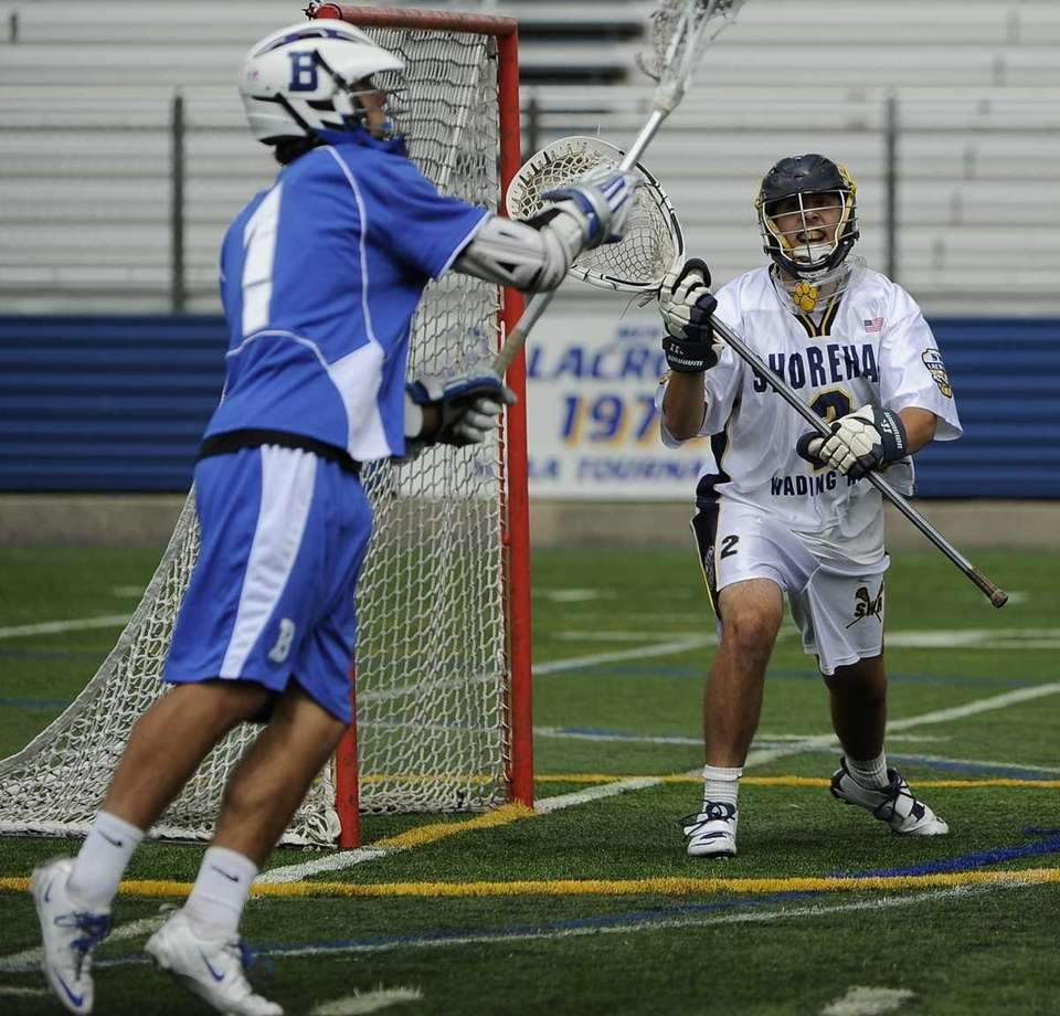 Shoreham-Wading River goalkeeper protects the goal against Bronxville