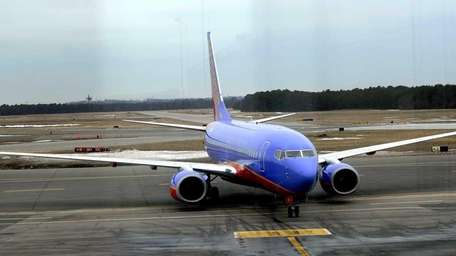 A Southwest airliner taxis to the terminal at