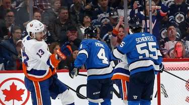 Islanders' Mathew Barzal (13) celebrates his goal against