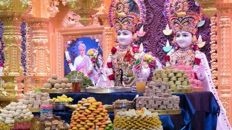 Diwali offerings of foods and other sweets at