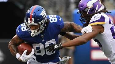 Giants tight end Evan Engram runs with the