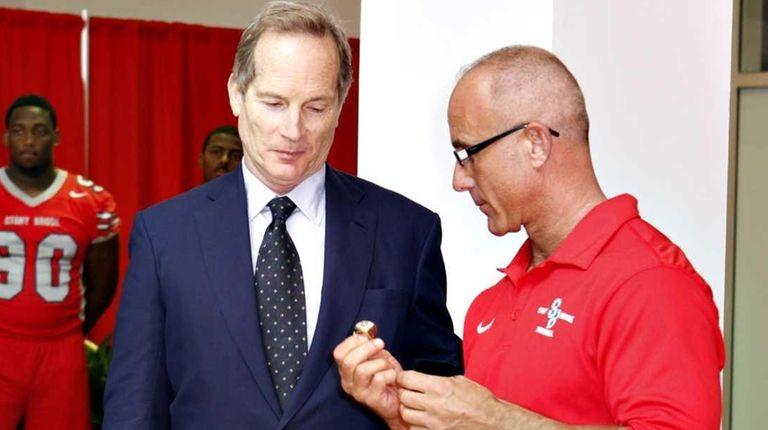 Alumnus/benefactor Glenn Dubin receives a championship ring from