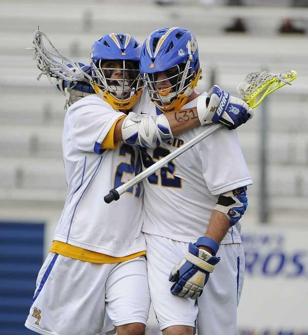 West Islip's Brendan Smith, right, celebrates his goal