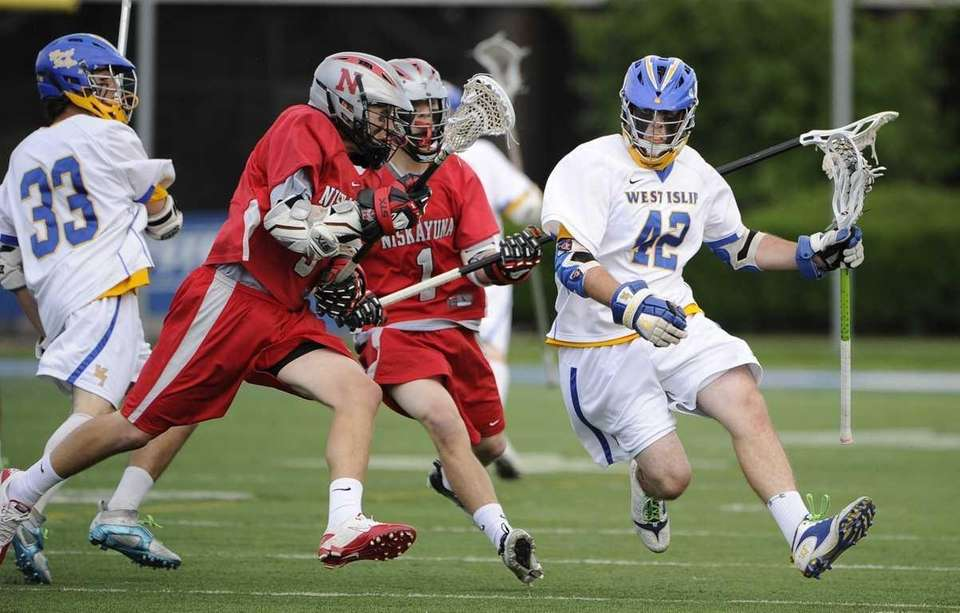 West Islip's Brendan Smith protects the ball from