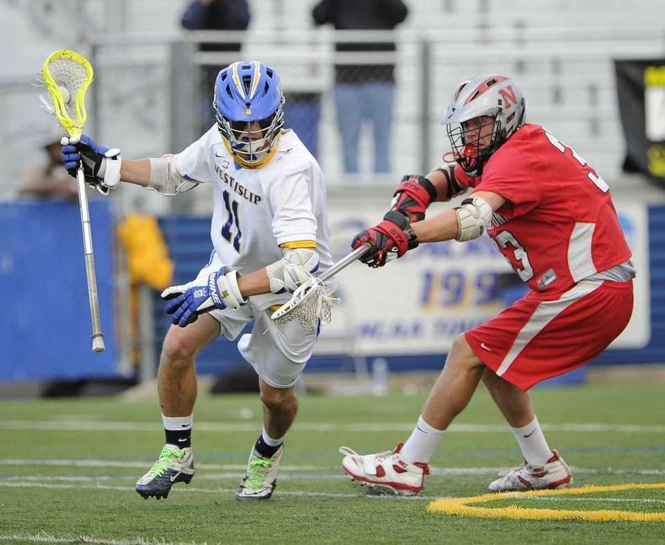 West Islip's Nick Aponte is pressured by a