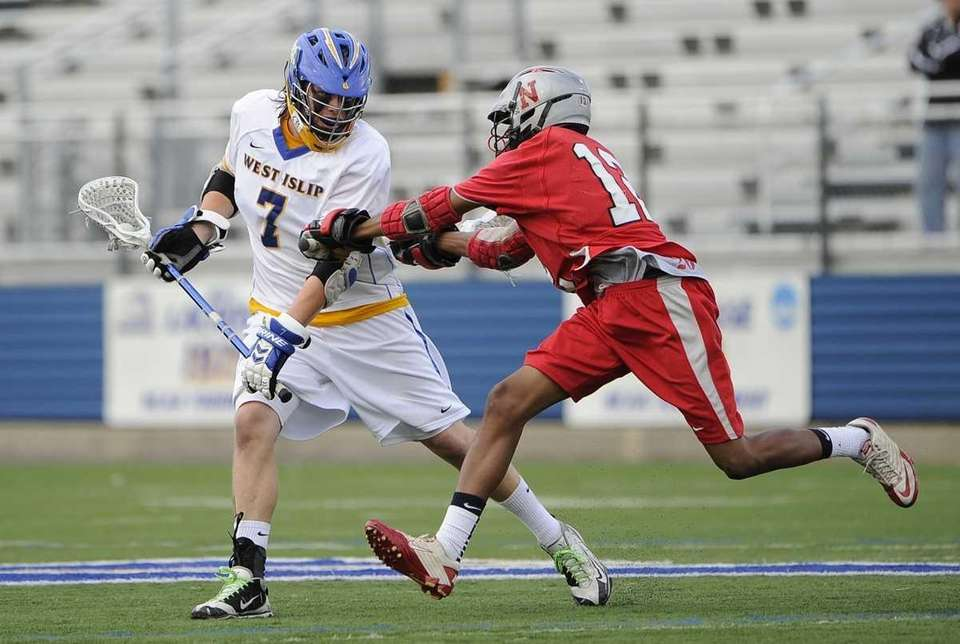 West Islip's Jon Reese is checked by Niskayuna's