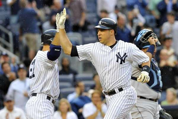 Mark Teixeira, right, gets a high-five from Raul