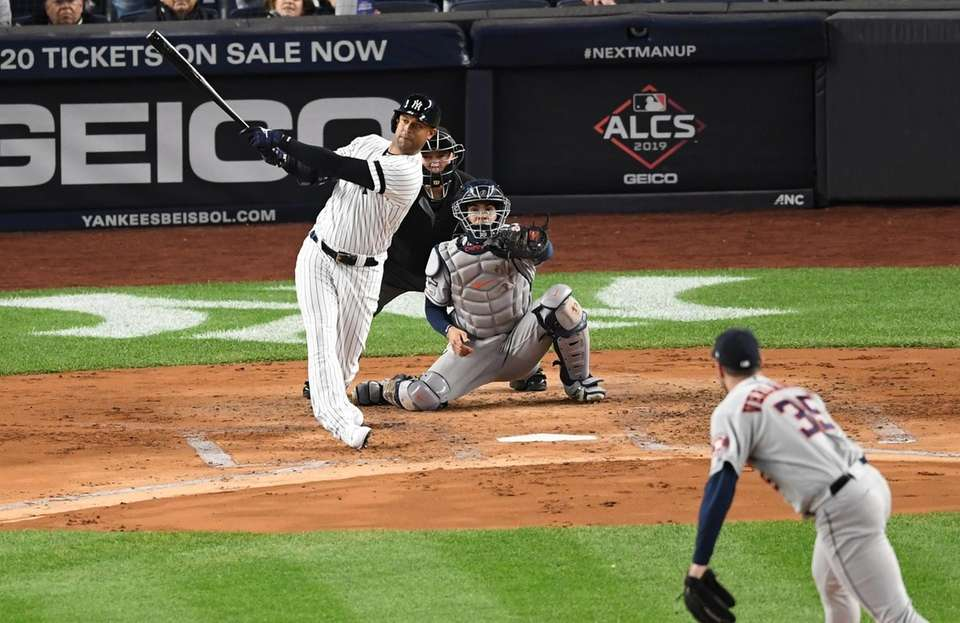 New York Yankees' Aaron Hicks hits a three-run