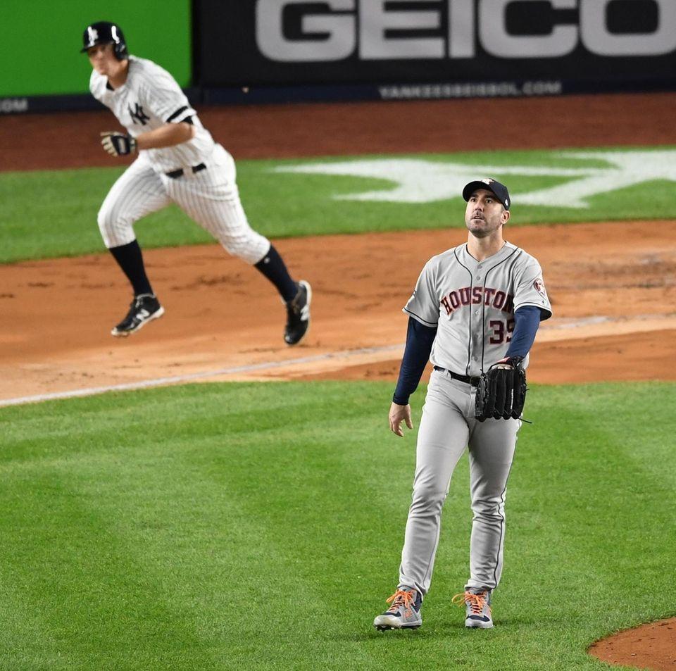Houston Astros starting pitcher Justin Verlander watches the