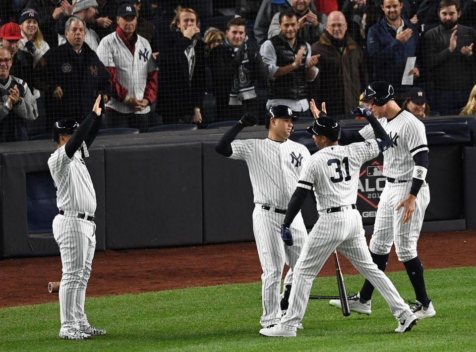 New York Yankees' Aaron Hicks (31) is greeted