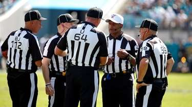 Officials discuss a ruling during the first half
