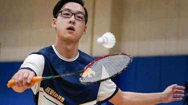 Gary Jiang of Jericho returns a serve during