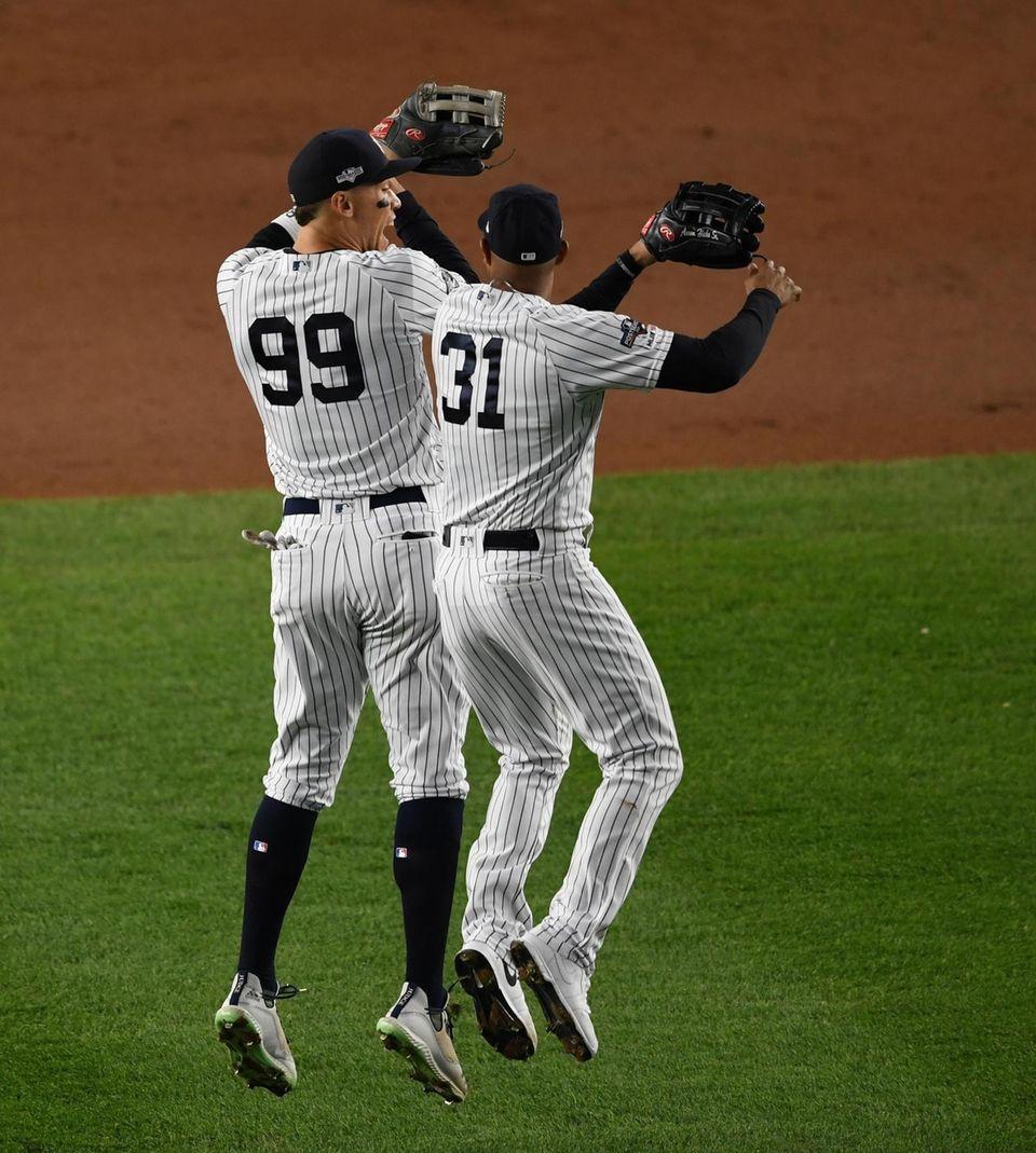 New York Yankees' Aaron Judge, left, and Aaron