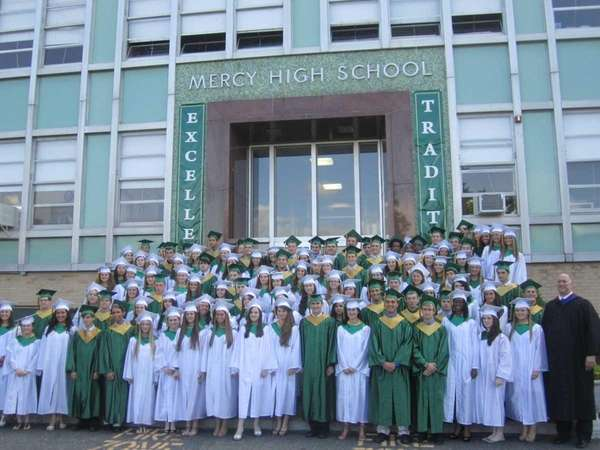 The graduates of McGann-Mercy High School stand in