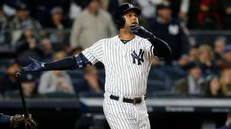 Aaron Hicks watches his long drive to rightfield,