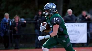 Westhampton Beach RB Aiden Cassera takes the pass