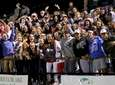 Westhampton Beach fans cheer on their team during