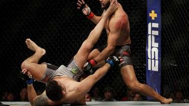 Dominick Reyes, right, knocks down Chris Weidman during