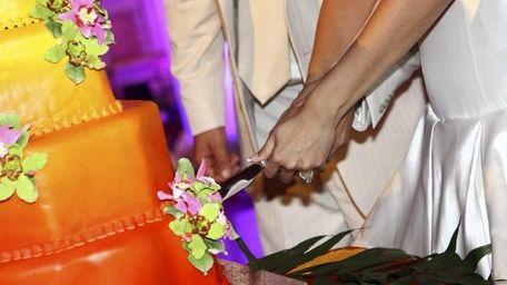 Rauly Berrios and Sergio Maldonado cut their wedding