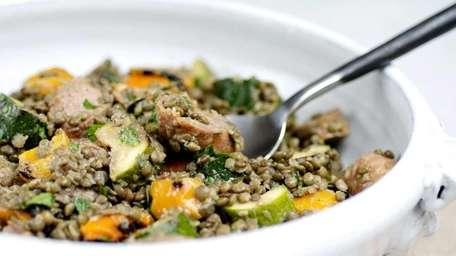 Lentil salad with grilled sausages, yellow and red