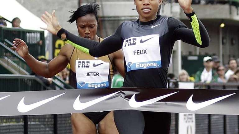 United States' Allyson Felix, right, wins the 200-meter