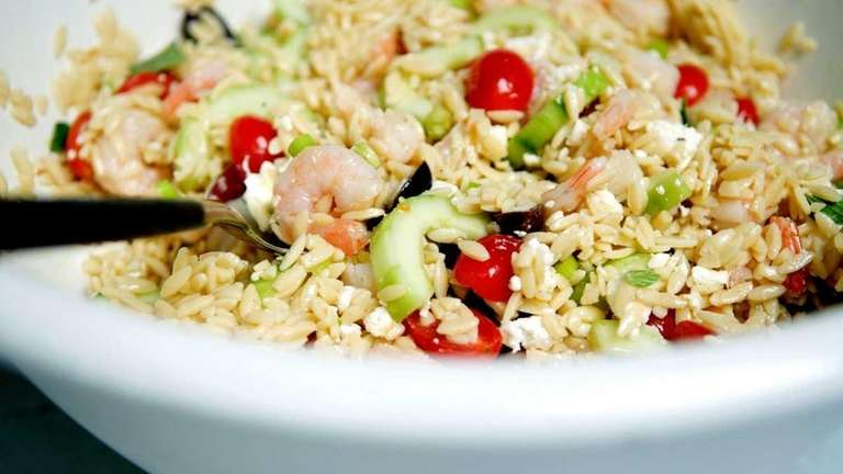 Orzo and shrimp salad, prepared with black olives,
