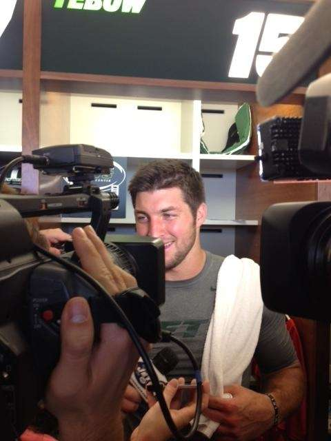 Tebow surrounded by media following Jets OTA session