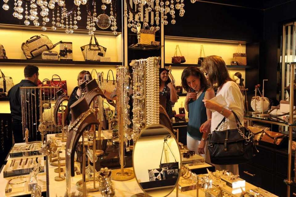 Shoppers browse merchandise in the newly opened Henri
