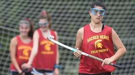 Sophia Guzzo of Sacred Heart Academy practices with