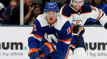 Mathew Barzal #13 of the Islanders skates with