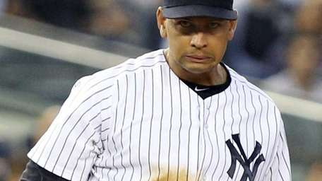 Alex Rodriguez reacts while watching his throwing error