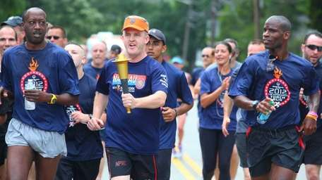 Nassau PD Chief Neil Delargy runs with the