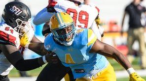 LIU defensive lineman Tavon Joseph (4) rushes against