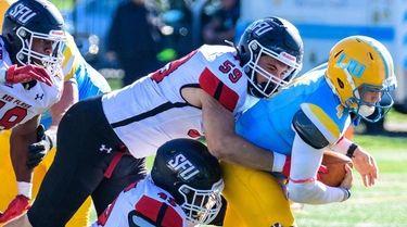 LIU quarterback Clay Beathard (4) is sacked by