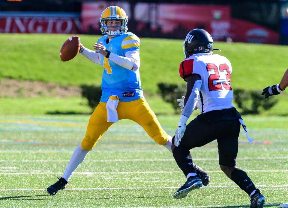 Long Island Sharks quarterback Clay Beathard (4) tries