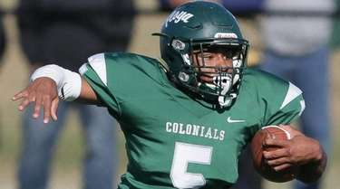 William Floyd's Jezayd Hall (5) runs the ball