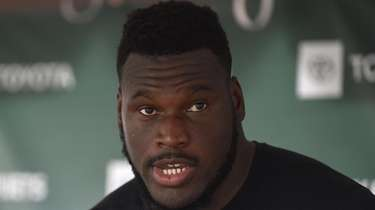 Kelechi Osemele #70, Jets guard, speaks with the