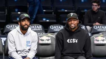 Brooklyn Nets guard Kyrie Irving (11) (left) and