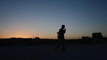 In this file photo, a U.S. Marine walks
