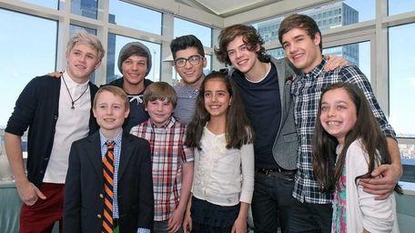Kidsday winners pose with members of