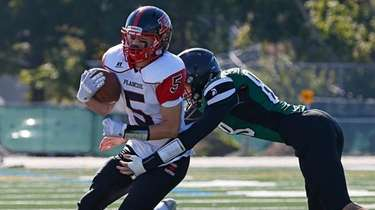 Luke Lombardi #5 of Plainedge runs the ball
